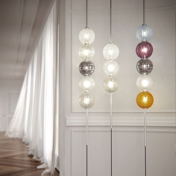 three floor lamps with colourful spherical glass bubbles