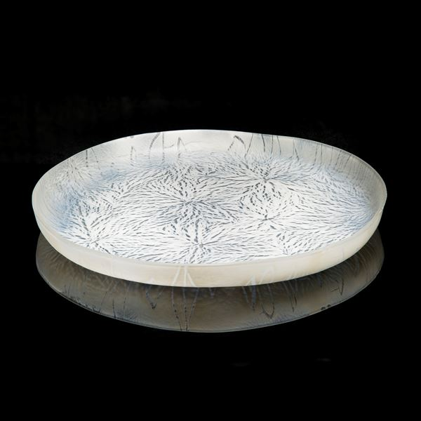 modern art glass sculpture of a large plate in white and black