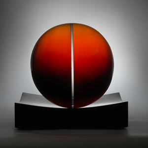 red minimalist art glass spherical sculpture with central line motif