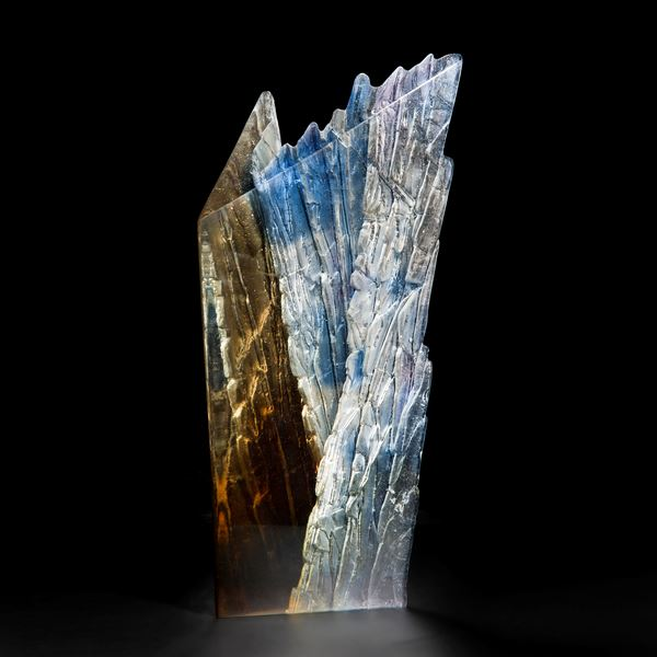 contemporary cast glass centrepiece of cliff edge in browns blues and greys