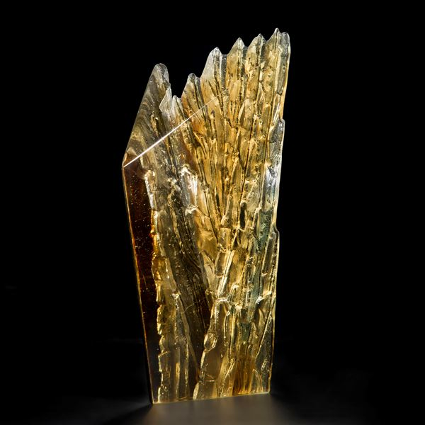 cast glass sculpture of rugged cliff edge in clar and dark colours