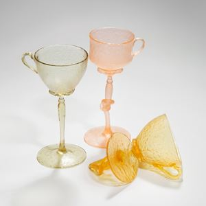 art-glass sculpture of tall glasses in green pink and orange