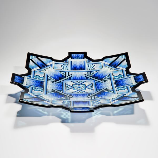 blue black and turquoise art-glass sculpture of flat bowl with pointed edges