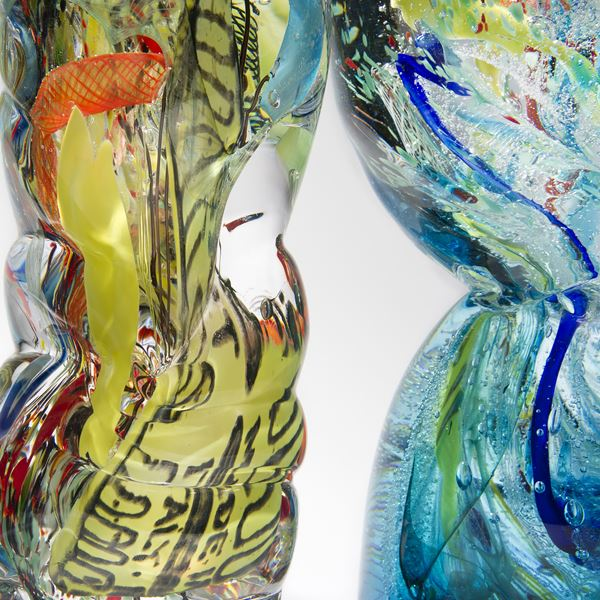 art-glass sculpture of crumpled wasted plastic bottles