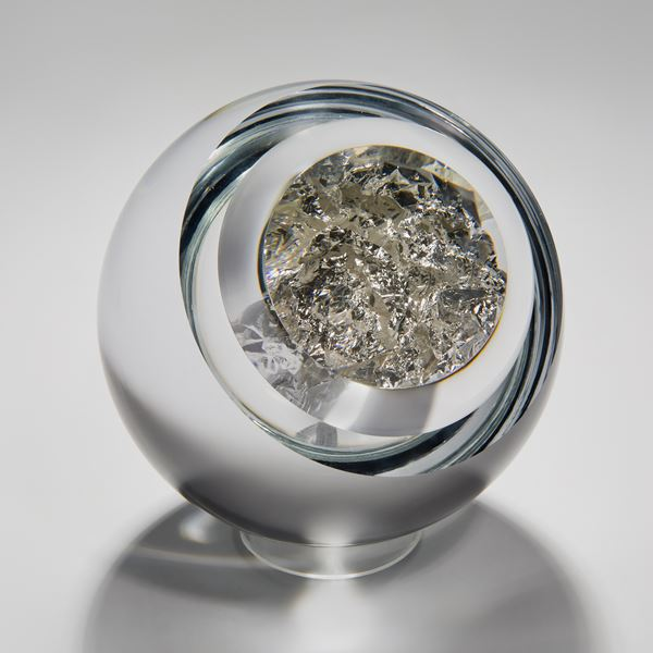 modern art glass orb sculpture with clear glass exterior and genuine silver interior