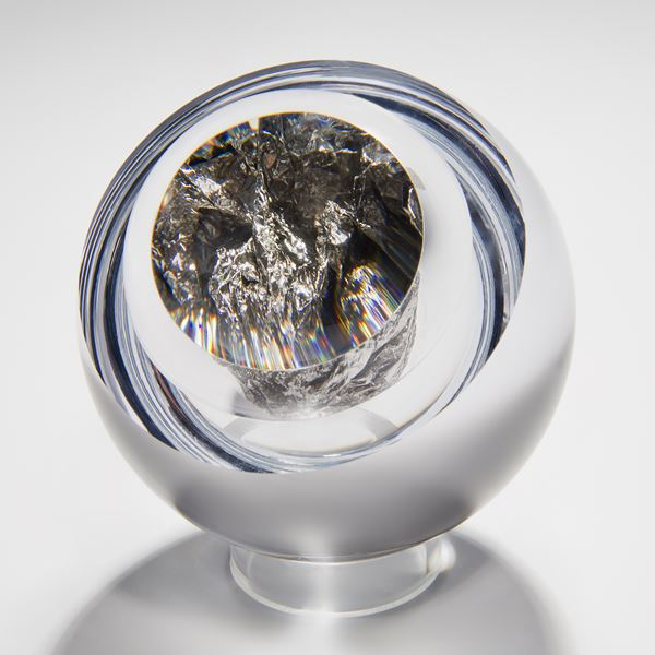 modern art glass orb sculpture with clear glass exterior and platinum interior