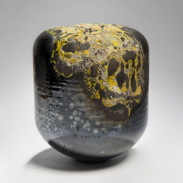 abstract contemporary glass sculpture in dark colours and yellow