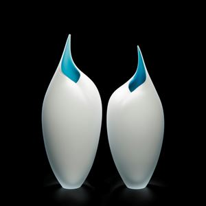 two art glass sculptures of bird like forms in white and turquoise