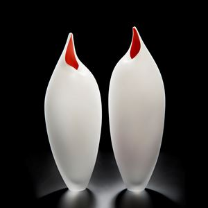 two white glass vases with red tips in the shape of birds