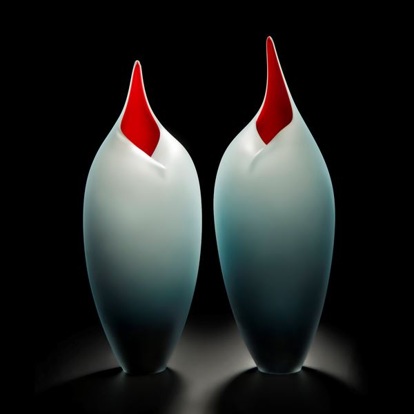 minimal blown glass sculpture of birds in red and steel