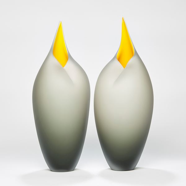 minimalist blown glass sculpture of birds in bronze and yellow