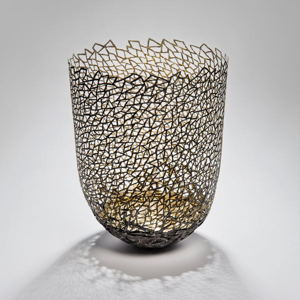 decorative vessel made from metal and wood with mesh exterior