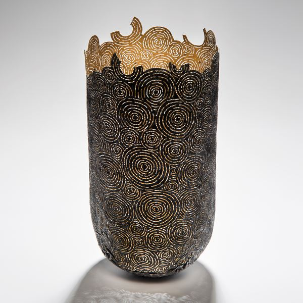 tall open top sculpted vessel made from circular cut pieces of metal and wood