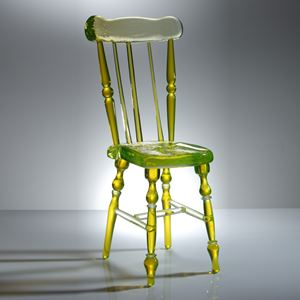 neon green coloured art glass sculpture of a chair