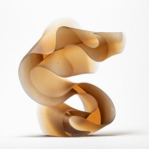 abstract contemporary glass art sculpture of swirling line in amber