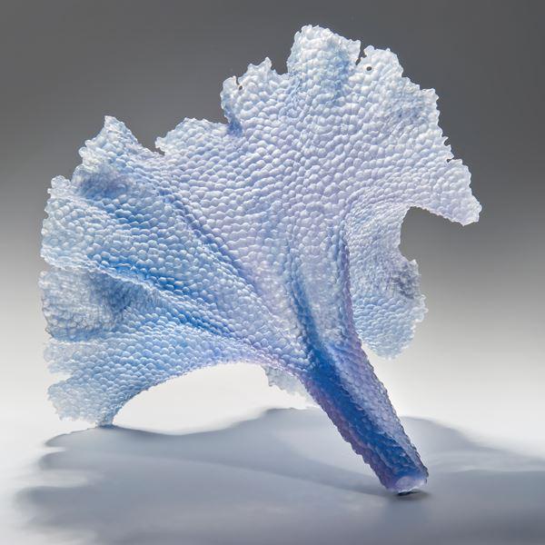 modern art glass sculpture of leaf in light blue