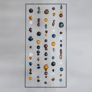 hanging art glass sculpture of brightly coloured pebble shaped glass pieces in rectangular frame