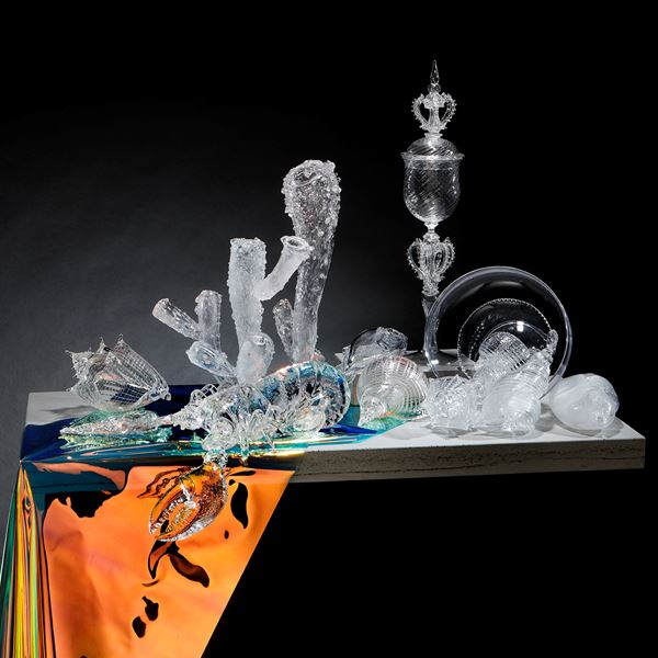 still life handblown and sculpted glass sculpture of objects on concrete table