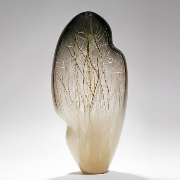 seethrough tall art glass sculpture with internal structure resembling abstract winter scene