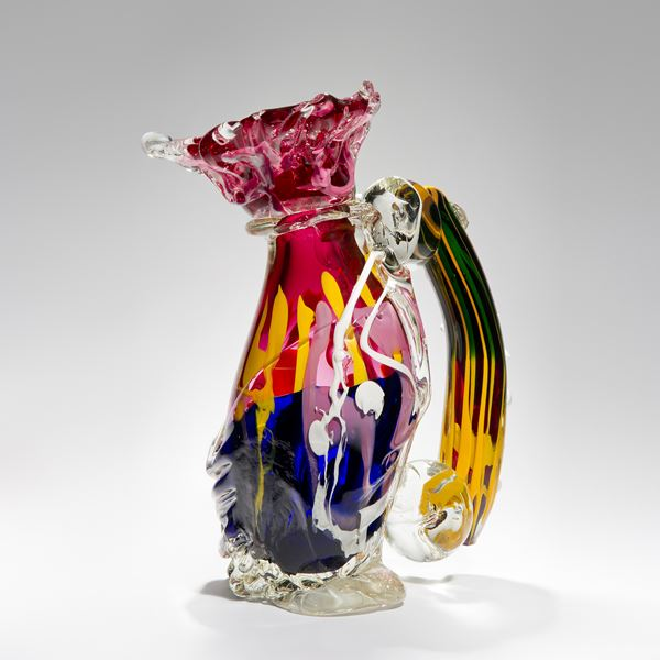 bright multicoloured ornamental art-glass sculpture of a jug