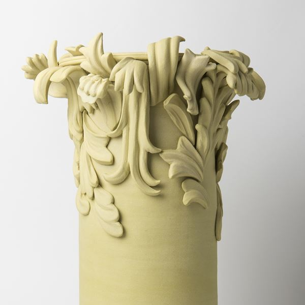 yellow contemporary ceramic vase sculpture in classical style with classical flower trim