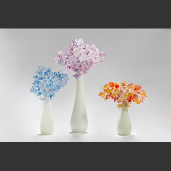 art glass sculpture of flowers in blue and pink