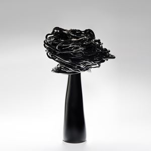black decorative art-glass ornamental sculpture of a flower in wind