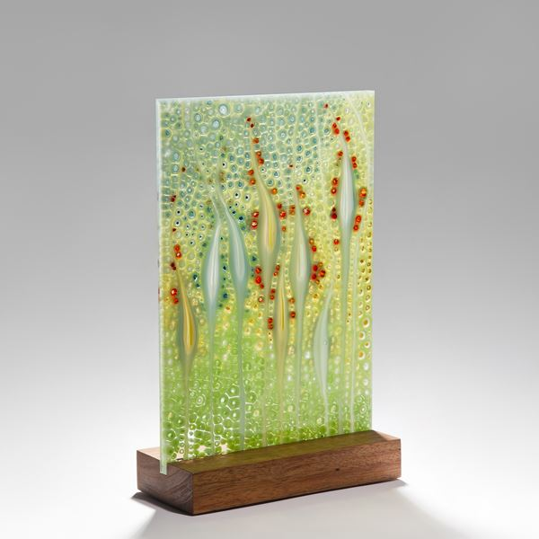 fused glass ornamental panel inspired by nature with walnut base