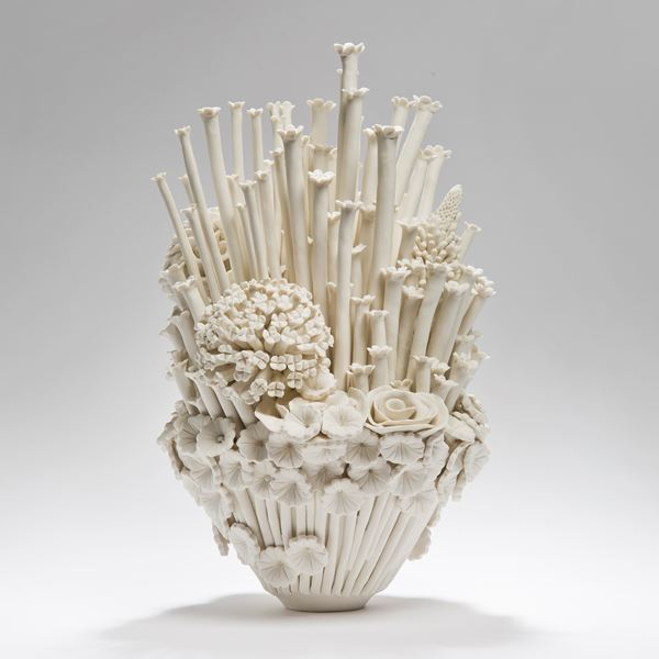 white porcelain sculpted artwork of roses sprouts and flowers