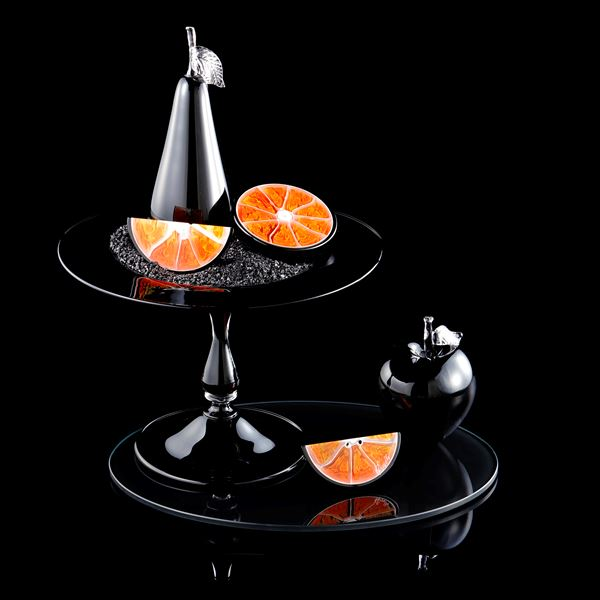 still life artwork in black carbon and orange made from handblown and sculpted glass