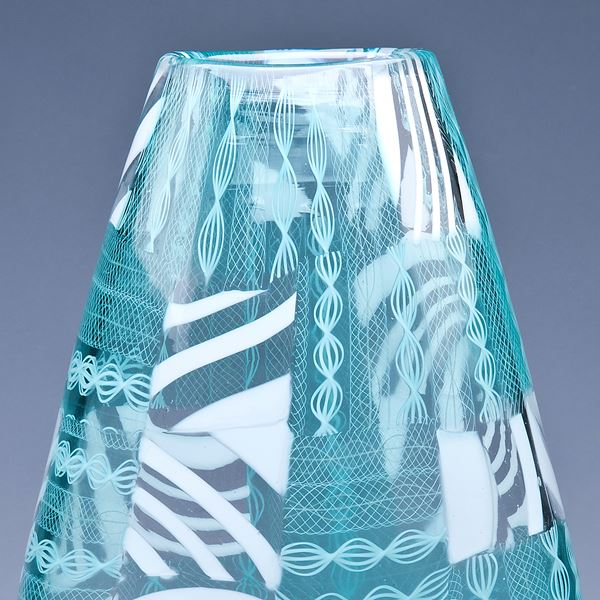art glass vase in turquoise and white with modern line patterns