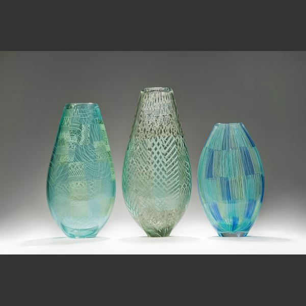 light blue art glass vase with faint green tint and faint lined pattern