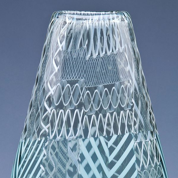 art glass vase in light green and grey with various external lined patterns
