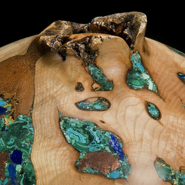wide sculpted vessel made from ash inlaid with precious minerals in green and gold