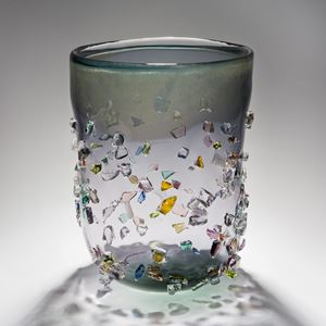 decorative glass vase sculpture in clear and light green and grey shades with external coloured crystals