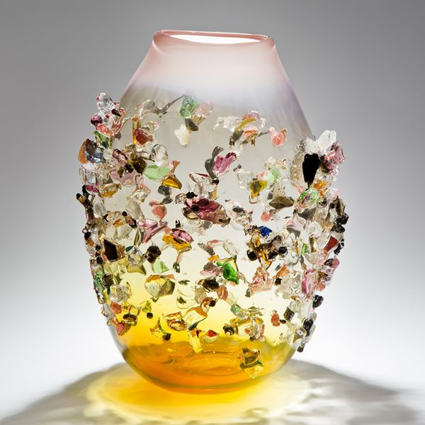 handblown glass vessel in amber and clear colours with multicoloured crystal adornments
