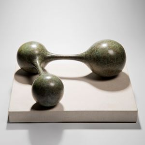 bronze minimalist sculpture of connected spheres on limestone base