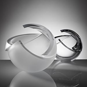 two pieces of minimalist spherical art glass sculpture