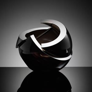 modern minimalist spherical art glass sculpture with sharp cuts in black