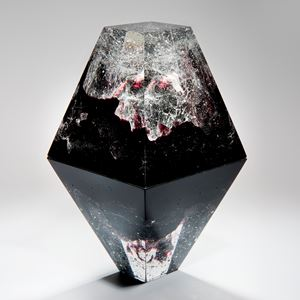 diamond shaped art-glass sculpture with plaster insert resembling frozen form in black crystal red