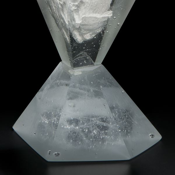 glass and plaster sculpture made to look like something trapped in diamond cut ice