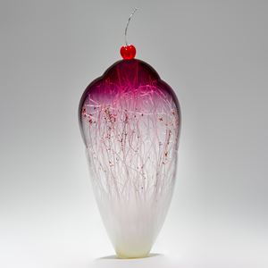 tall and thin decorative glass ornament in white and pink with natural looking internal structure and cherry on top