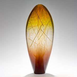 tall curved amber and coffee coloured glass sculpture with delicate nature-inspired internal structure