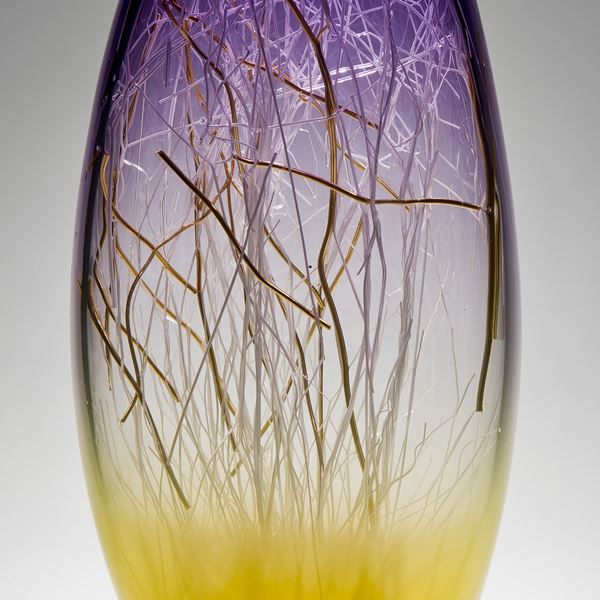 tall curved hyacinth and primrose coloured glass sculpture with delicate nature-inspired internal structure