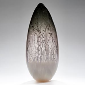 sculpted glass vessel in grey with wire interior resembling winter forest
