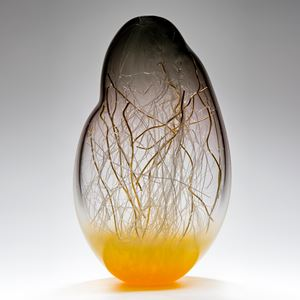 sculpted glass vessel in grey and yellow with internal wire structure