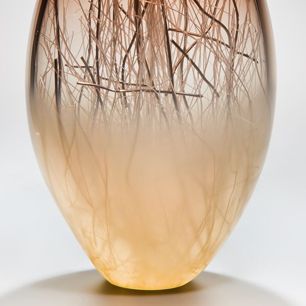 art glass sculpture in brown and cream with internal wire structure