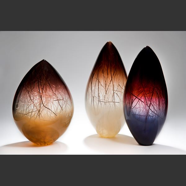 art glass sculpture in orb shape with aubergine and coffee colours and internal wire structure