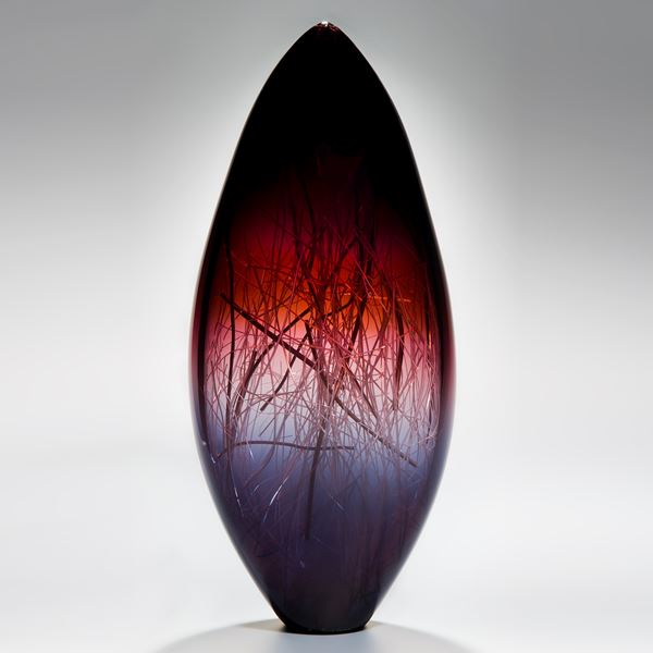 tall sculpted glass vase in deep violet red and black with internal wire structure