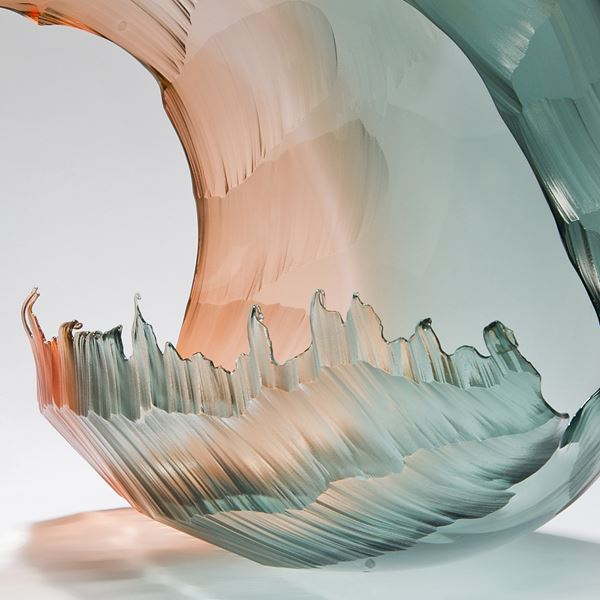 blown and sculpted art-glass ornament of wave in pink and turquoise